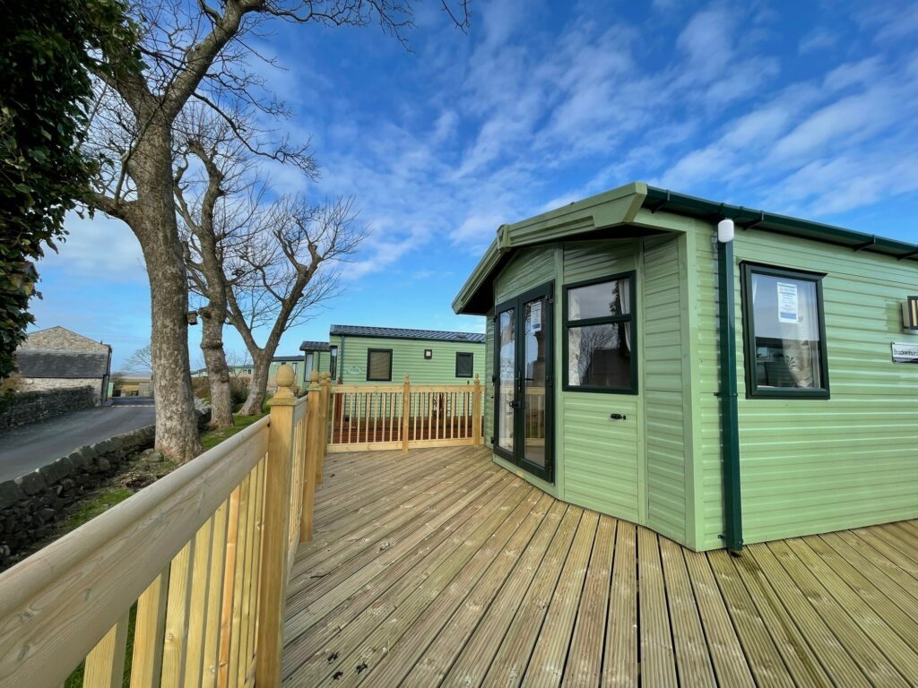 View of deck and lane at Brockenhurst Holiday Home, Bay View Holiday Park, North West, Morecambe Bay
