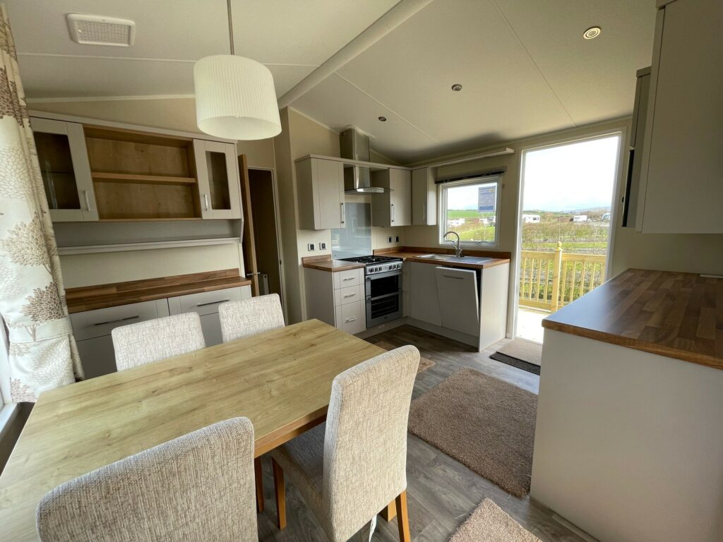 View of kitchen and dining area in Willerby Winchester Holiday Home at Bay View Holiday Park, North West, Morecambe Bay