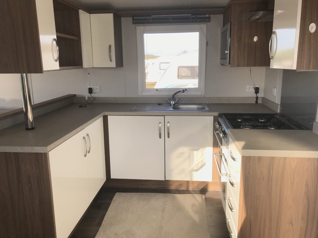Kitchen with hob and sink in cabin at Willerby, Avonmore, Bay View Holiday Park- Holgate