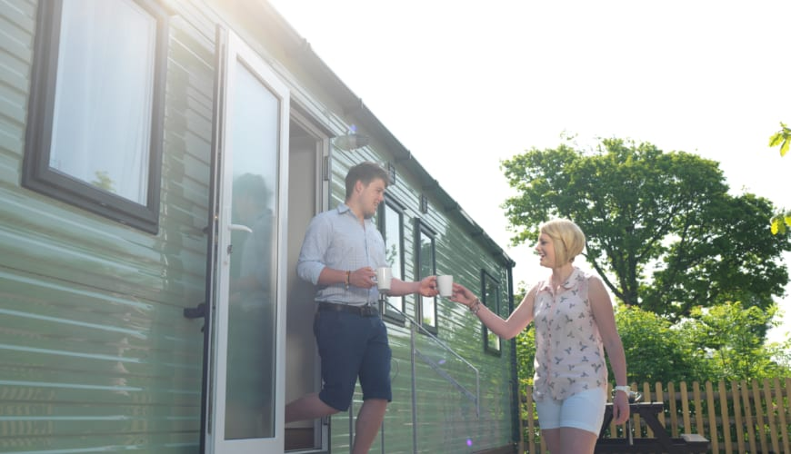 Holgates Holiday parks in Lancashire - Couple next to caravan